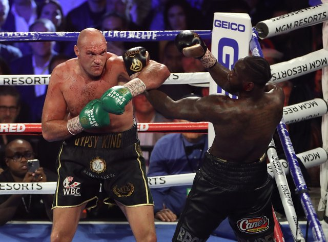 Tyson Fury (left) and Deontay Wilder during their WBC world heavyweight title bout in Las Vegas