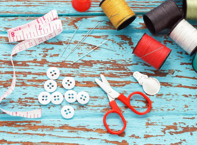 Scissors and sewing supplies laid out on a table