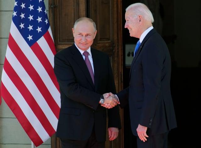 Russian president Vladimir Putin, left, and US president Joe Biden shake hands ahead of their summit
