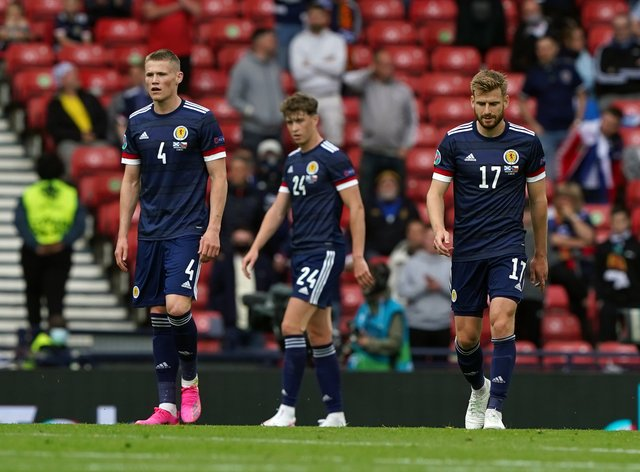 Scotland's Scott McTominay, Jack Hendry and Stuart Armstrong stand dejected at Hampden Park