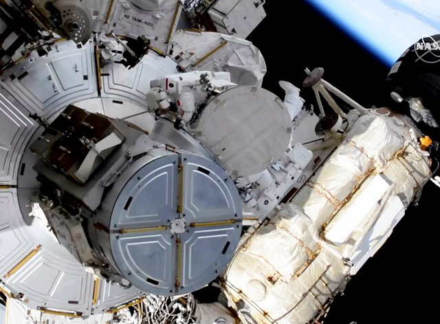 French astronaut Thomas Pesquet, top centre, and Nasa astronaut Shane Kimbrough venture out on a spacewalk