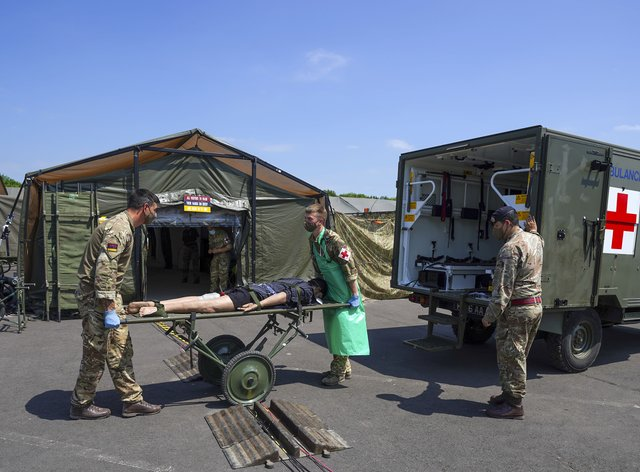 Medical staff from the military services during a test of the Army Medical Service's Mytchett based 22 Field Hospital, at Barton Stacey in Hampshire
