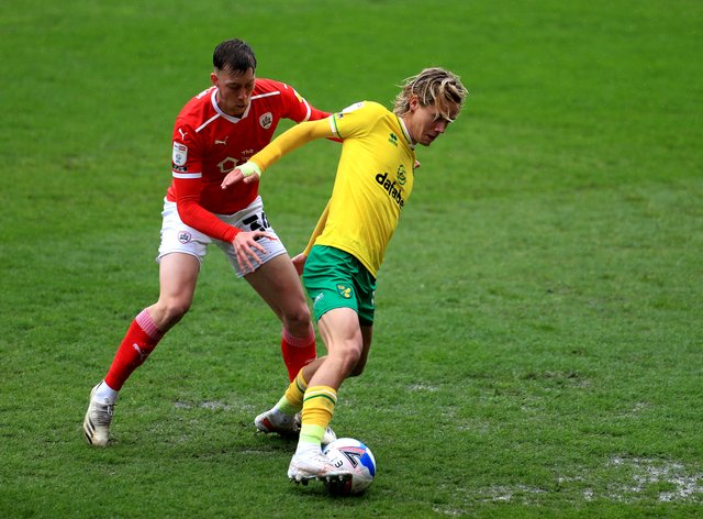 Barnsley's Jasper Moon (left) and Norwich City's Todd Cantwell battle for the ball during the Sky Bet Championship match at Oakwell Stadium, Barnsley.