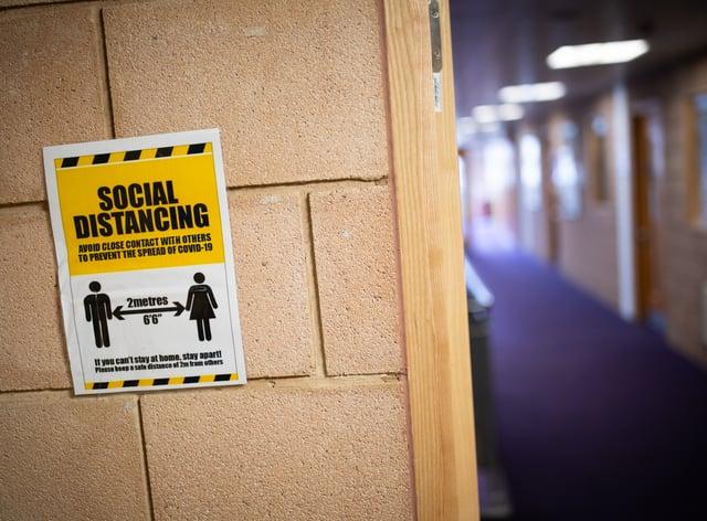 A social distancing sign