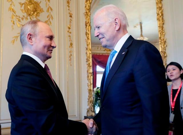 US president Joe Biden, right, and Russian president Vladimir Putin, shake hands during their meeting in Switzerland