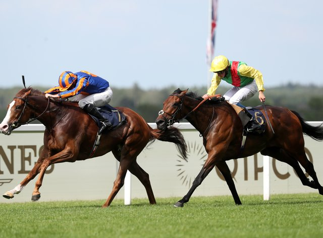 Love and Ryan Moore (left) had to battle hard to beat Audarya in the Prince of Wales's Stakes at Royal Ascot