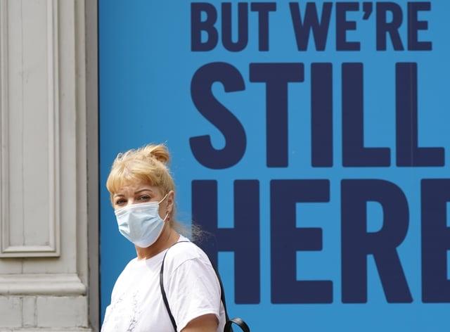 Woman wears face mask