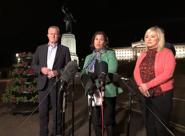 Mary Lou McDonald speaks to reporters outside Stormont in the early hours of Thursday flanked by party colleagues Michelle O'Neill and Conor Murphy