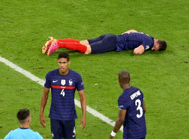 French medical officials say Benjamin Pavard, top, did not lose consciousness or suffer a concussion after his collision with Germany's Robin Gosens on Tuesday