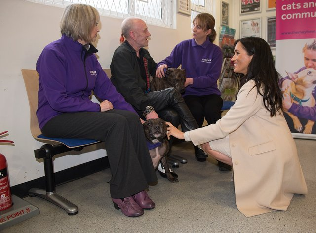 The Duchess of Sussex meets Wully Struthers and his staffies Azzy and Gallis during a visit to animal welfare charity Mayhew