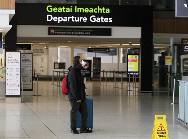 Man wears face mask in airport
