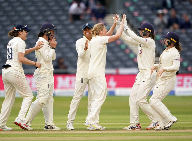 England's players celebrate a wicket