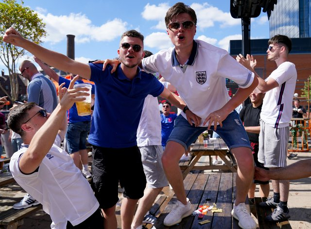 <p>England fans celebrate after watching the Euro 2020 match between England and Croatia</p>