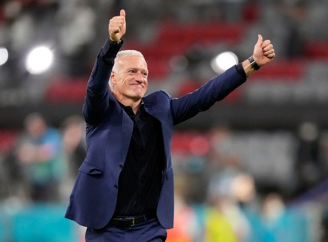 Didier Deschamps salutes the French fans after his side's opening group win in Munich against Germany