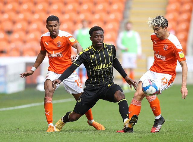 David Tutonda, centre, in action for Bristol Rovers