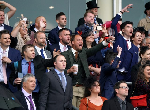 Racegoers cheer during the Coronation Stakes