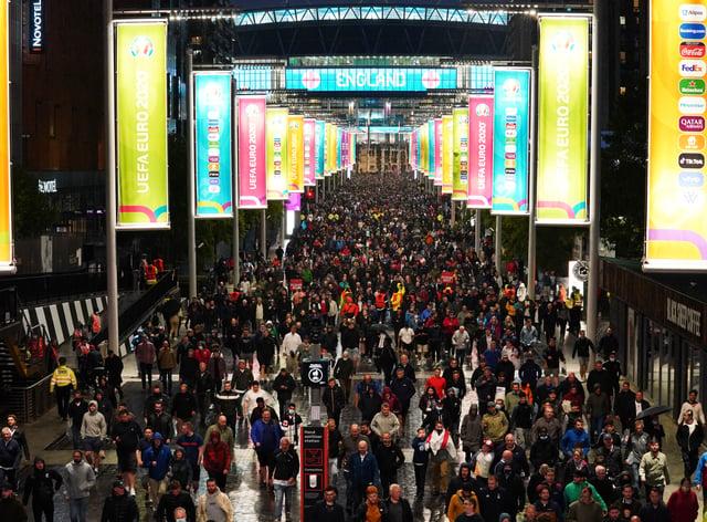 <p>Fans outside Wembley Stadium</p>