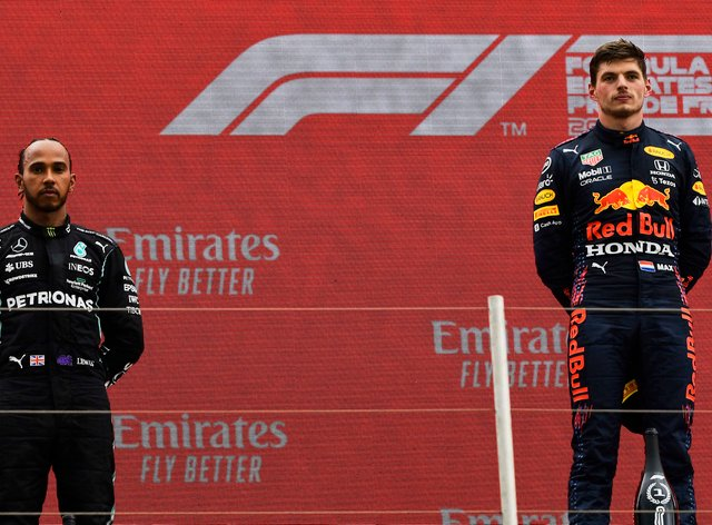 Red Bull driver Max Verstappen, right, and Lewis Hamilton of Mercedes on the podium