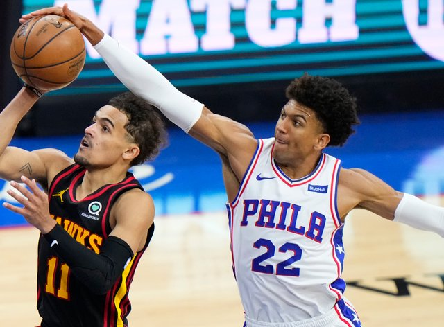 Philadelphia 76ers' Matisse Thybulle, right, blocks a shot by Atlanta Hawks' Trae Young during the second half of Game 7