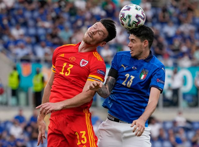 Wales striker Kieffer Moore in action against Italy