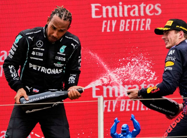 Lewis Hamilton and Max Verstappen spray champagne