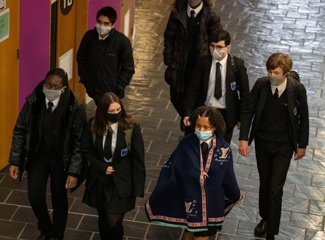 Schoolchildren wearing face masks