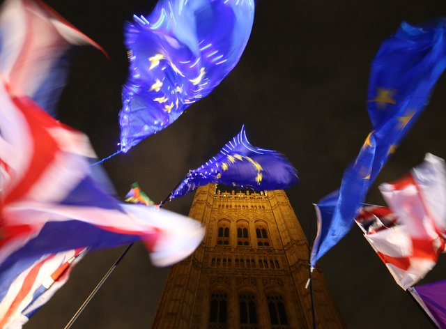 Union and EU flags outside the Houses of Parliament