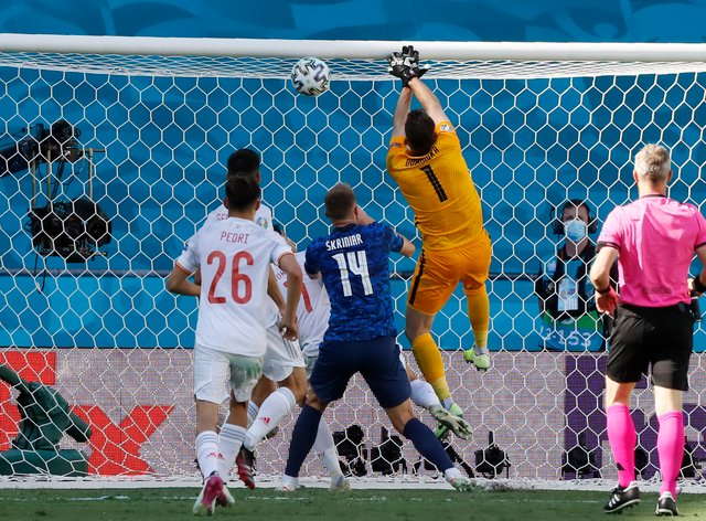 <p>Martin Dubravka punches into his own net</p>