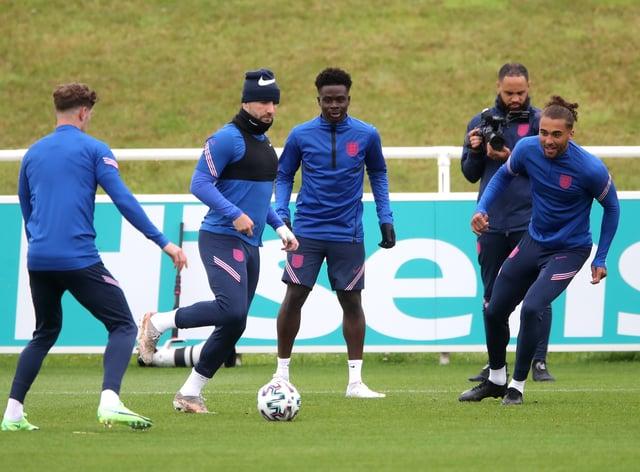 Luke Shaw, left, says everyone in the England squad loves Bukayo Saka