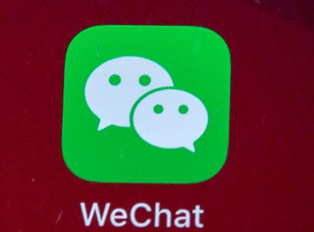 An icon for the smartphone app WeChat (Mark Schiefelbein/AP)