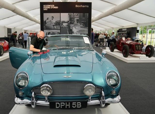Chris Bailey, of Bonhams, cleans the 1964 Aston Martin DB5 convertible