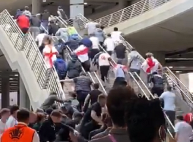 England fans run up the stairs after breaking past security at Wembley