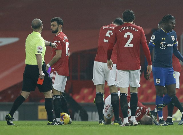 Alex Jankewitz (right) leaves the game after being shown a red card against Manchester United (Phil Noble/PA)