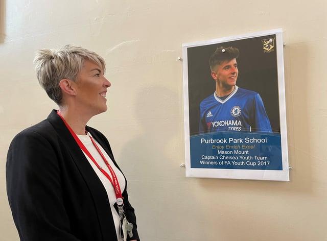 Deputy headteacher Emma Bolton and a photograph of former pupil Maso