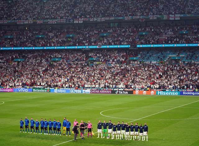 <p>Italy and England players line up ahead of the Euro 2020 final at Wembley Stadium in London</p>