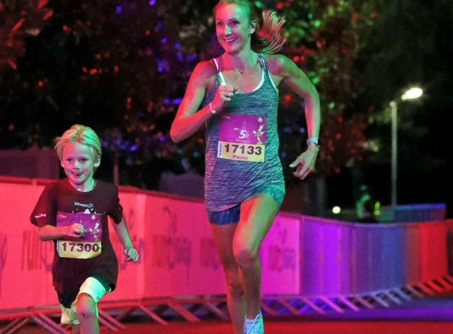 Paula Radcliffe runs with her son Raphael