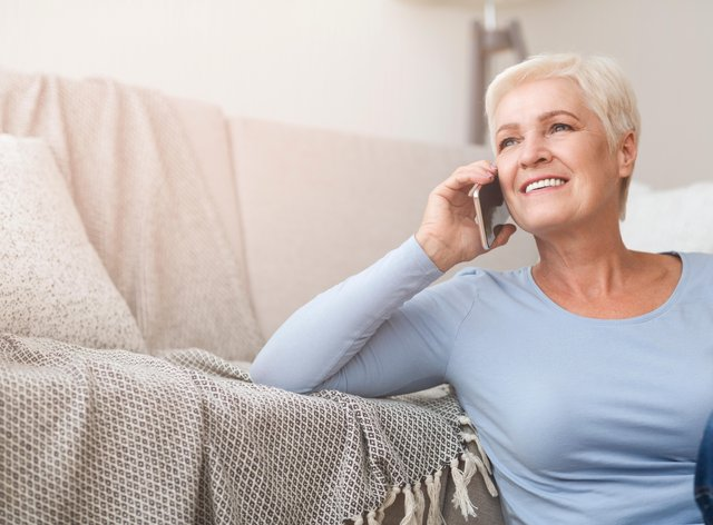 Female pensioner on the phone