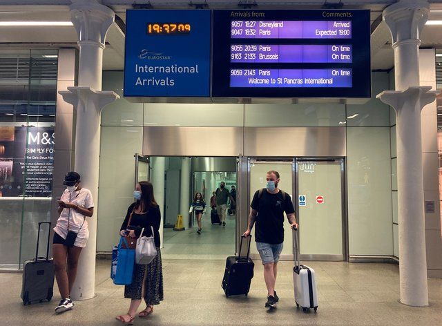 Travellers arriving from the Eurostar at St Pancras International railway station