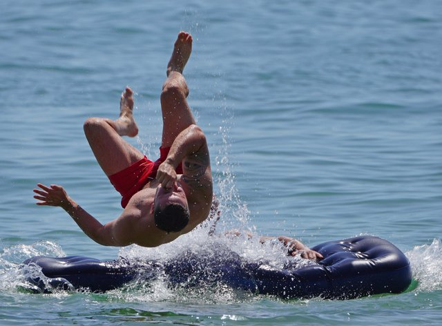 A man jumps in the sea