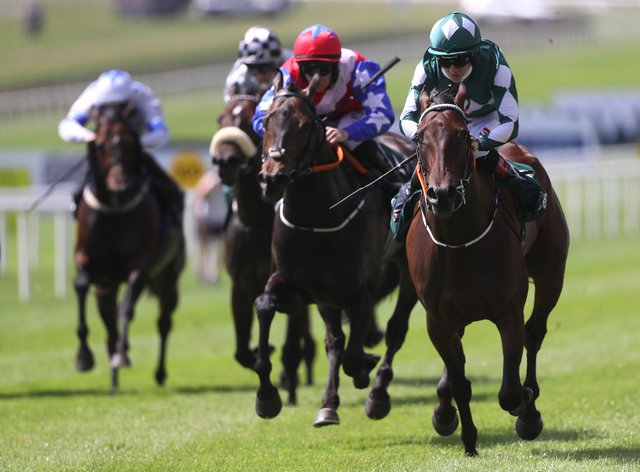 Mooneista (right) takes command to win the Paddy Power Sapphire Stakes at the Curragh