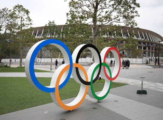 Two athletes have become the first to test positive in the Olympic Village