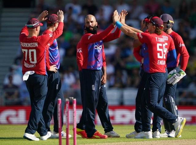 Moeen Ali (centre) celebrates taking the wicket of Fakhar Zaman