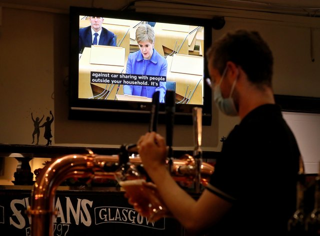 Nicola Sturgeon on TV in pub