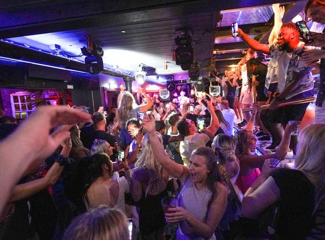 People dancing in a Leeds bar