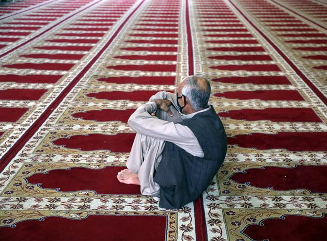 A Muslim worshipper offers Eid al-Adha prayers in Kabul, Afghanistan (Rahmat Gul/AP)