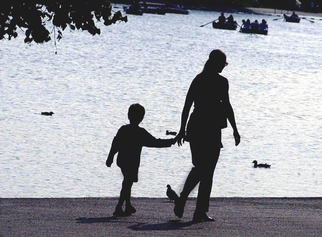 A woman walking with a child