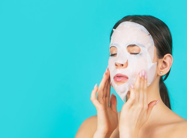 Woman wearing skincare sheet mask