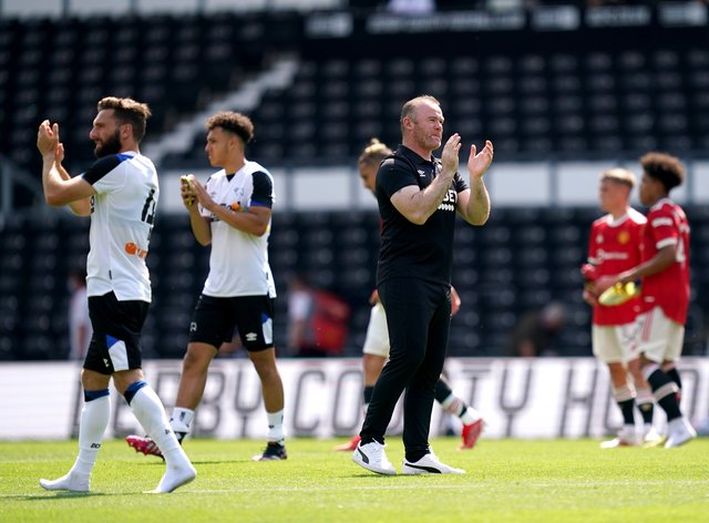 Derby manager Wayne Rooney applauds the fans
