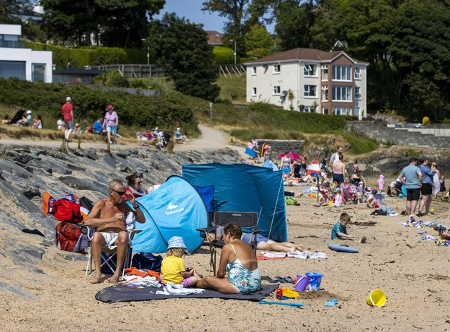 People enjoying the sun at Helen's Bay beach in County Down, Northern Ireland