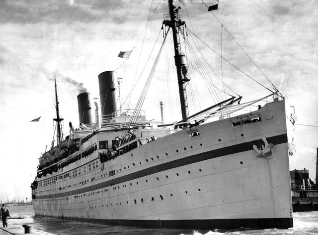 The then troopship 'Empire Windrush' docked in Southampton (PA)